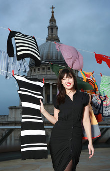 Daisy Lowe hangs up donated clothes to launch the TK Maxx Give up Clothes for Good campaign in support of Cancer Research UK Kids and Teens, at Madison Rooftop Terrace in London